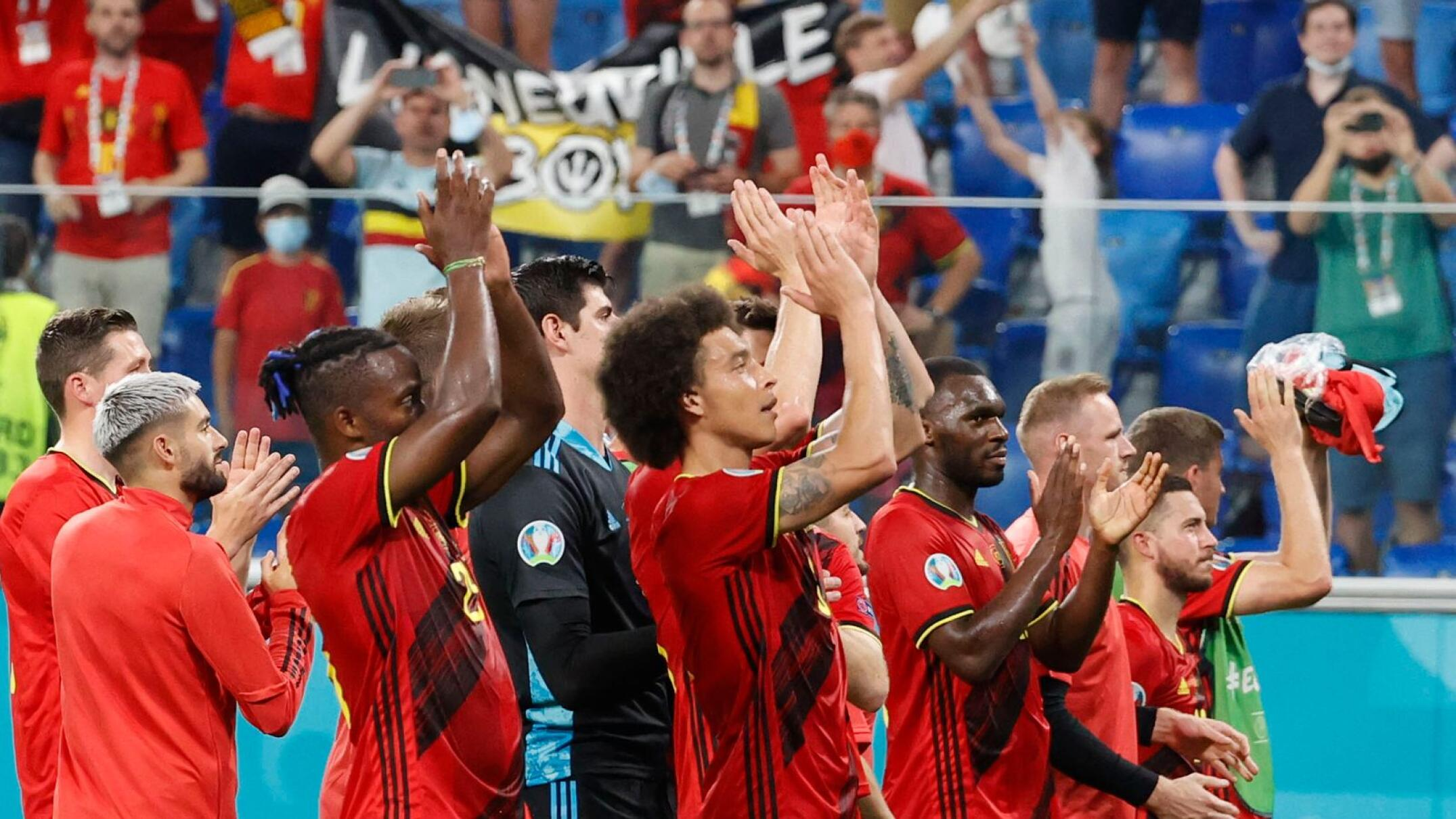 Belgium players celebrate at the end of their Euro 2020 match against Finland at Saint Petersburg Stadium in Russia