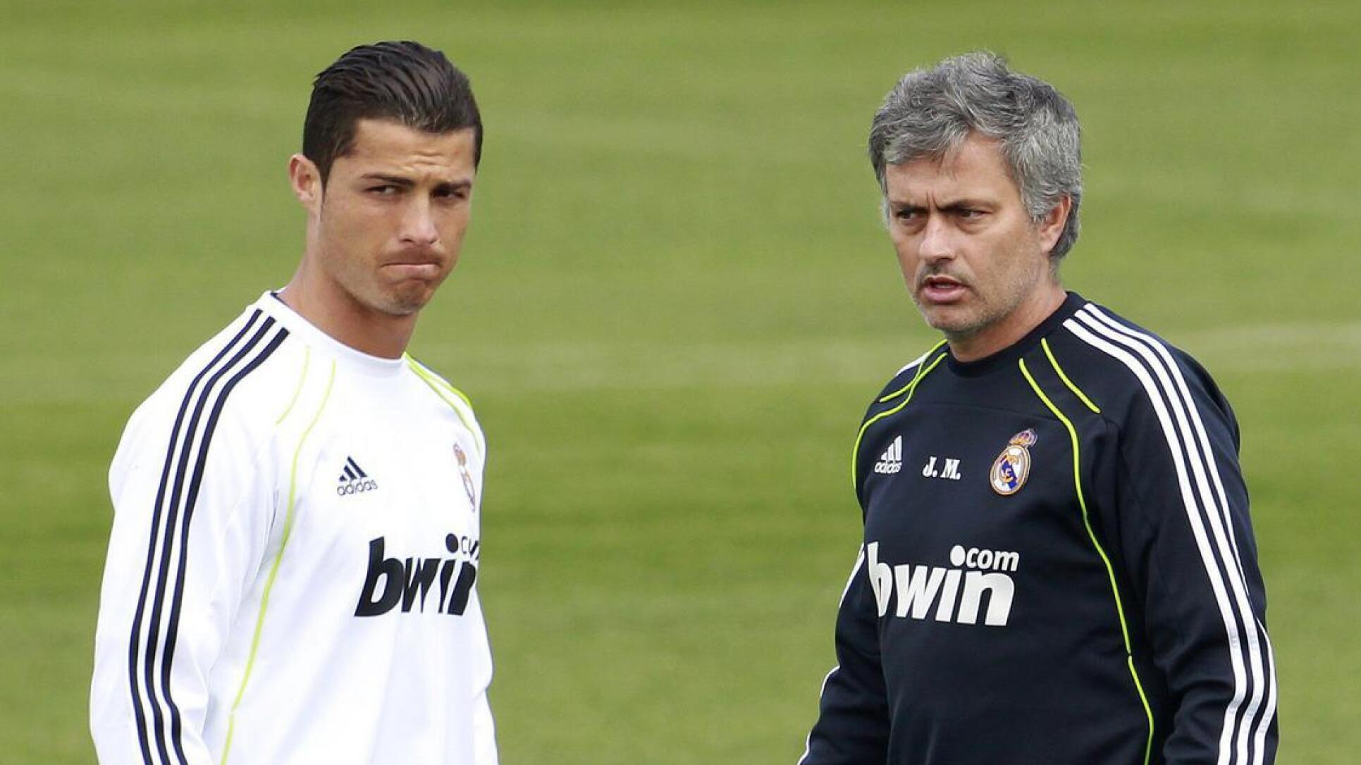 Former Real Madrid coach Jose Mourinho walks next to former star Cristiano Ronaldo