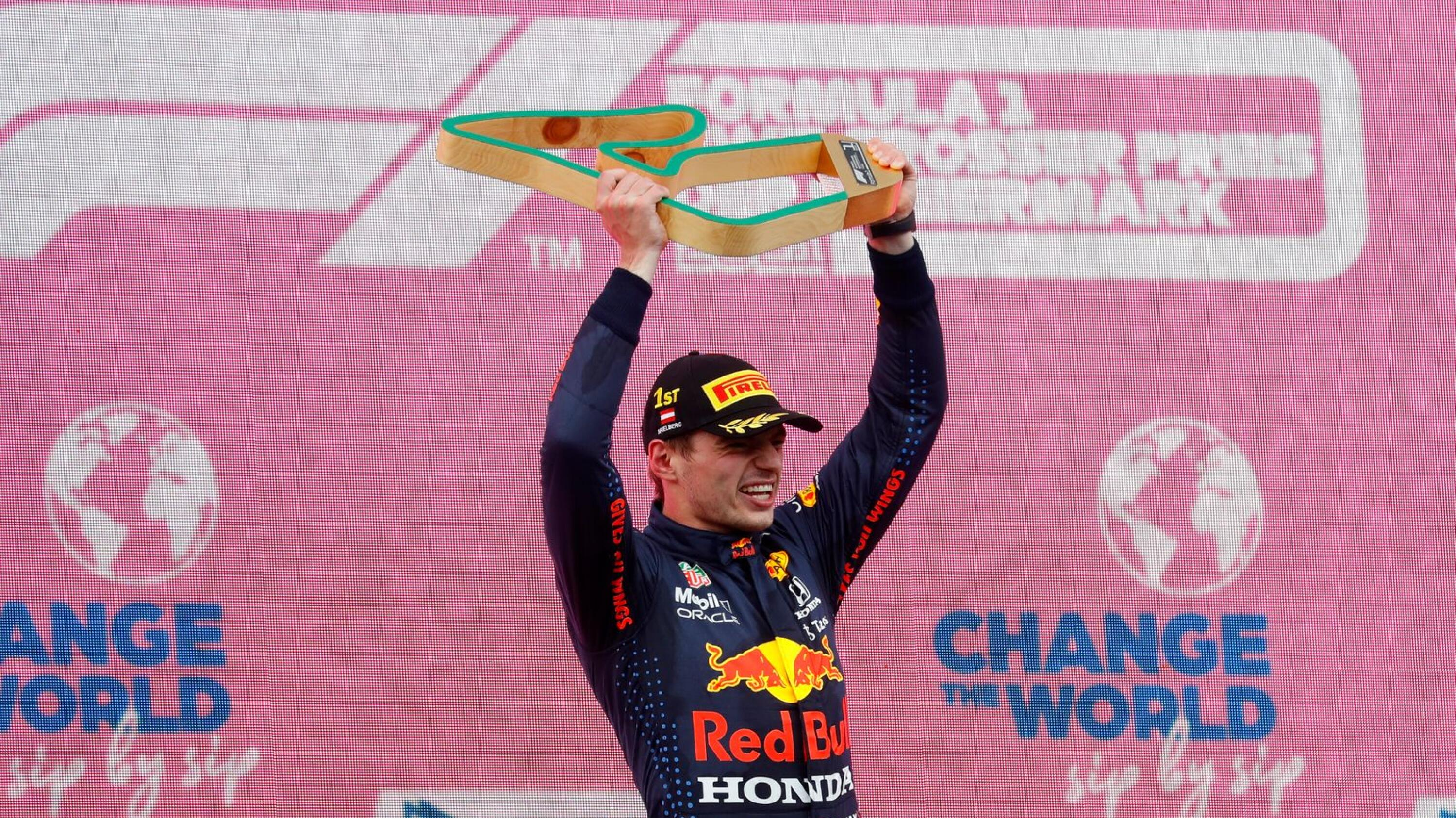 Red Bull's Max Verstappen celebrates with the trophy after winning the Styrian Grand Prix in Spielberg on Sunday