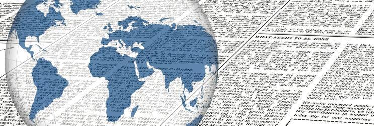 newspaper under globe overlay