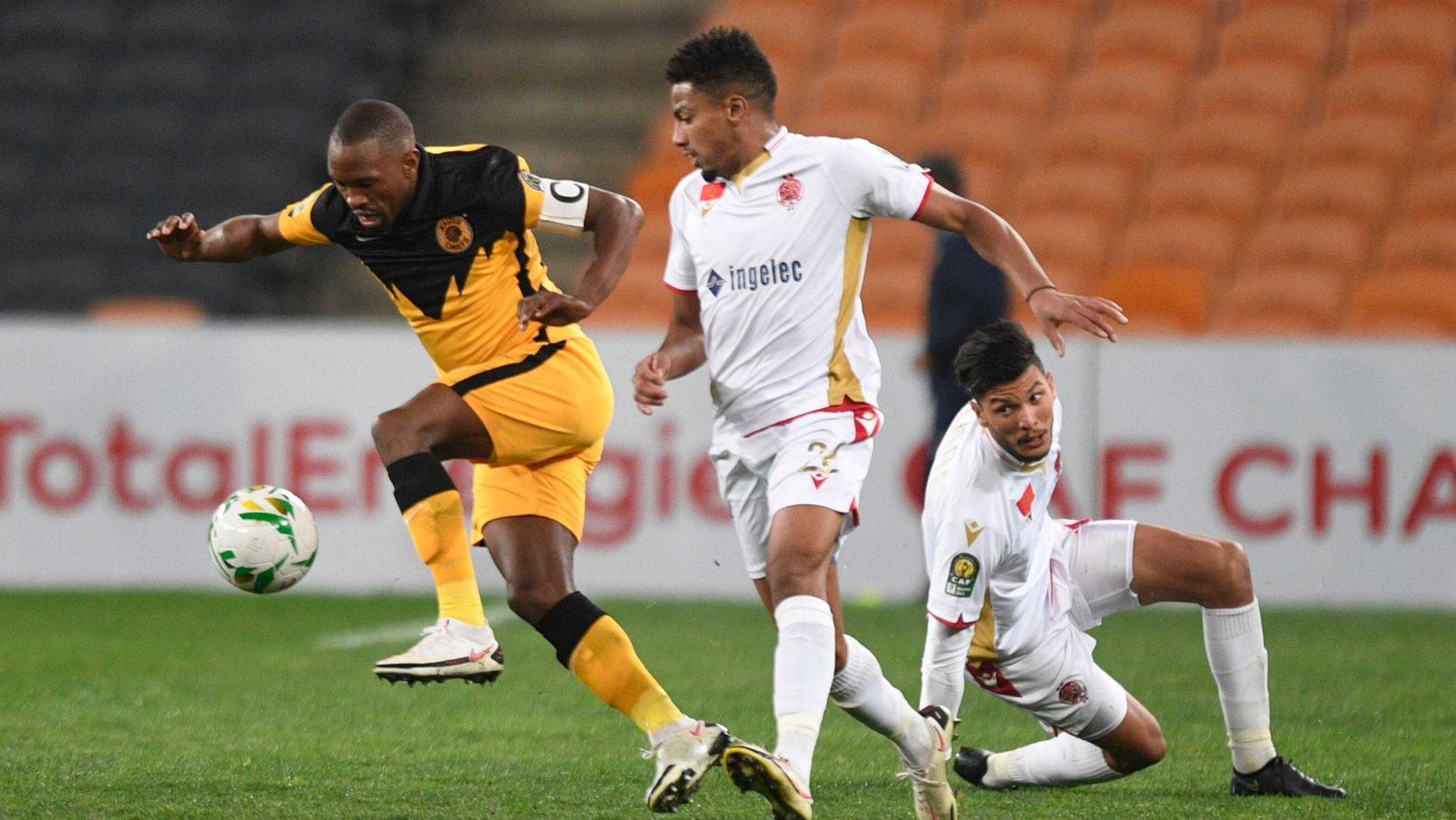 Bernard Parker of Kaizer Chiefs is challenged by Ayoub El Amloud of Wydad Casablanca during their Caf Champions League semi final second Leg match at FNB Stadium in Soweto, Johannesburg on Saturday