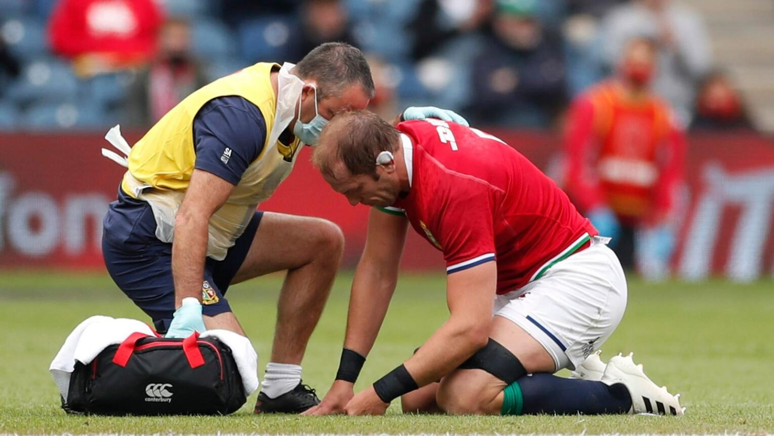 British and Irish Lions' captain Alun Wyn Jones receives medical attention after sustaining a shoulder injuryduring their game against Japan at  Murrayfield in Edinburgh on Saturday