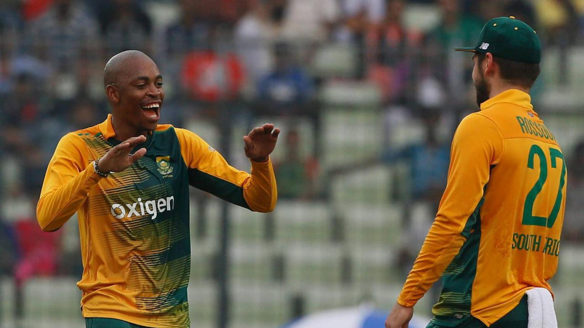 South Africa's Aaron Phangiso celebrates a wicket with teammate Rilee Rossouw during a Twenty20 International against Bangladesh in Dhaka in 2015