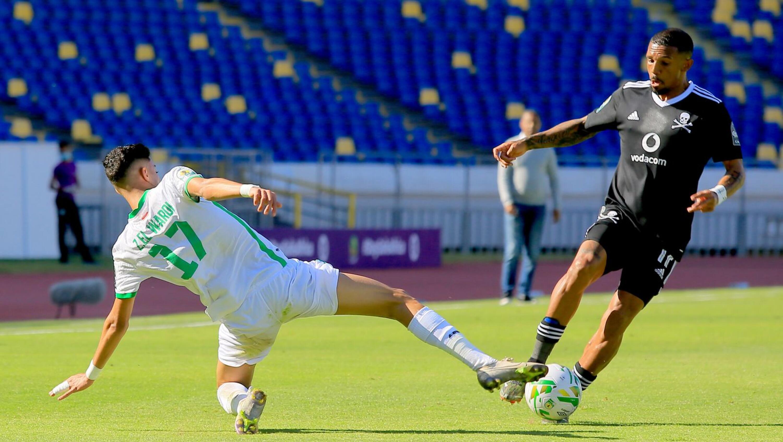 Wayde Jooste of Orlando Pirates is tackled by Zakaria Wardi of Raja Casablanca