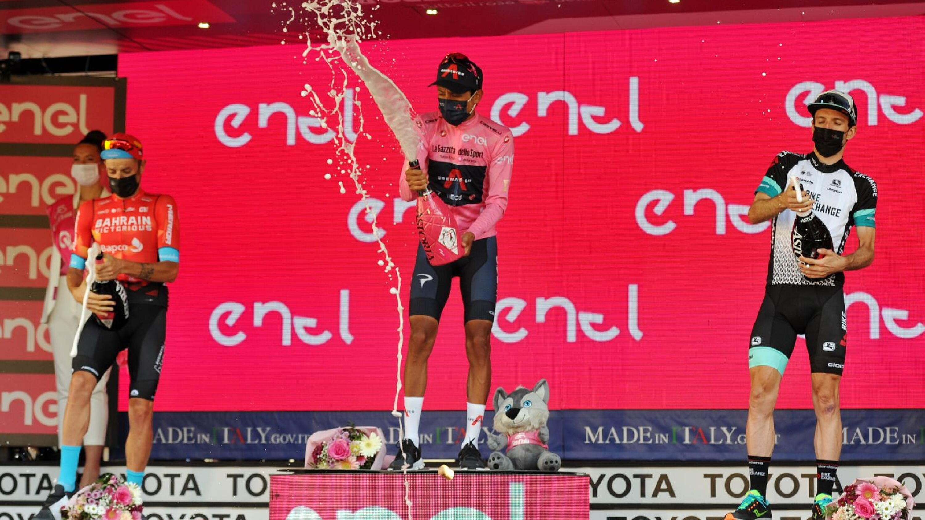 Ineos Grenadiers rider Egan Arley Bernal Gomez of Colombia on the podium as he celebrates wearing the maglia rosa