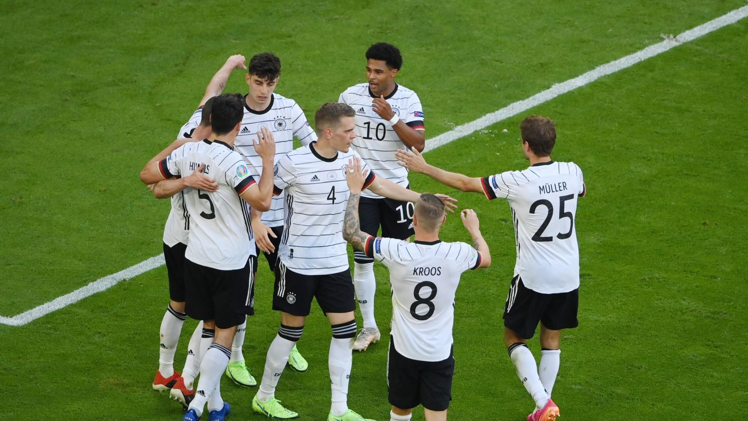 Germany's Kai Havertz celebrates with teammates after scoring their third goal in their Euro 2020 game against Portugal at the Allianz Arena in Munich on Saturday