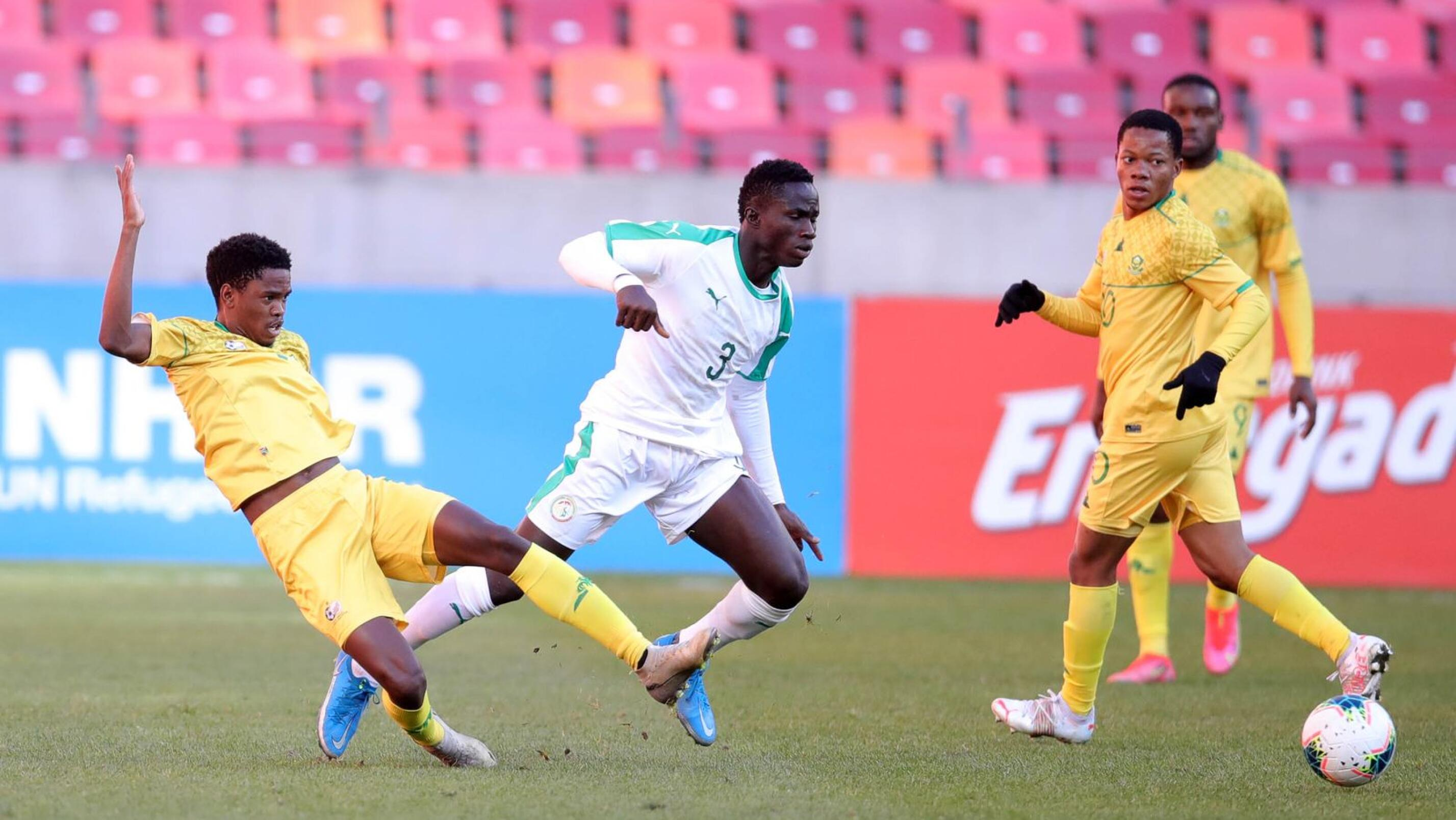 Woula Macire Sane of Senegal is challenged by Sifiso Stanley Ngobeni of South Africa during their 2021 Cosafa Cup final at Nelson Mandela Bay Stadium in Gqebrha on Sunday