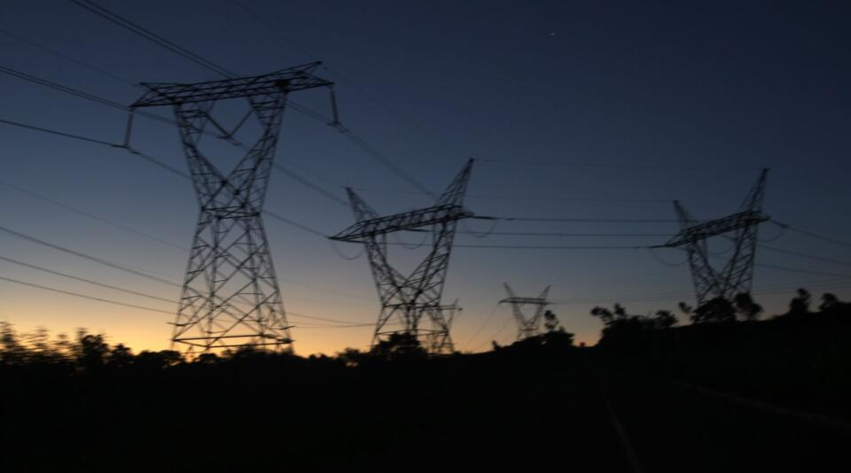Electricity pylons seen at sunset.