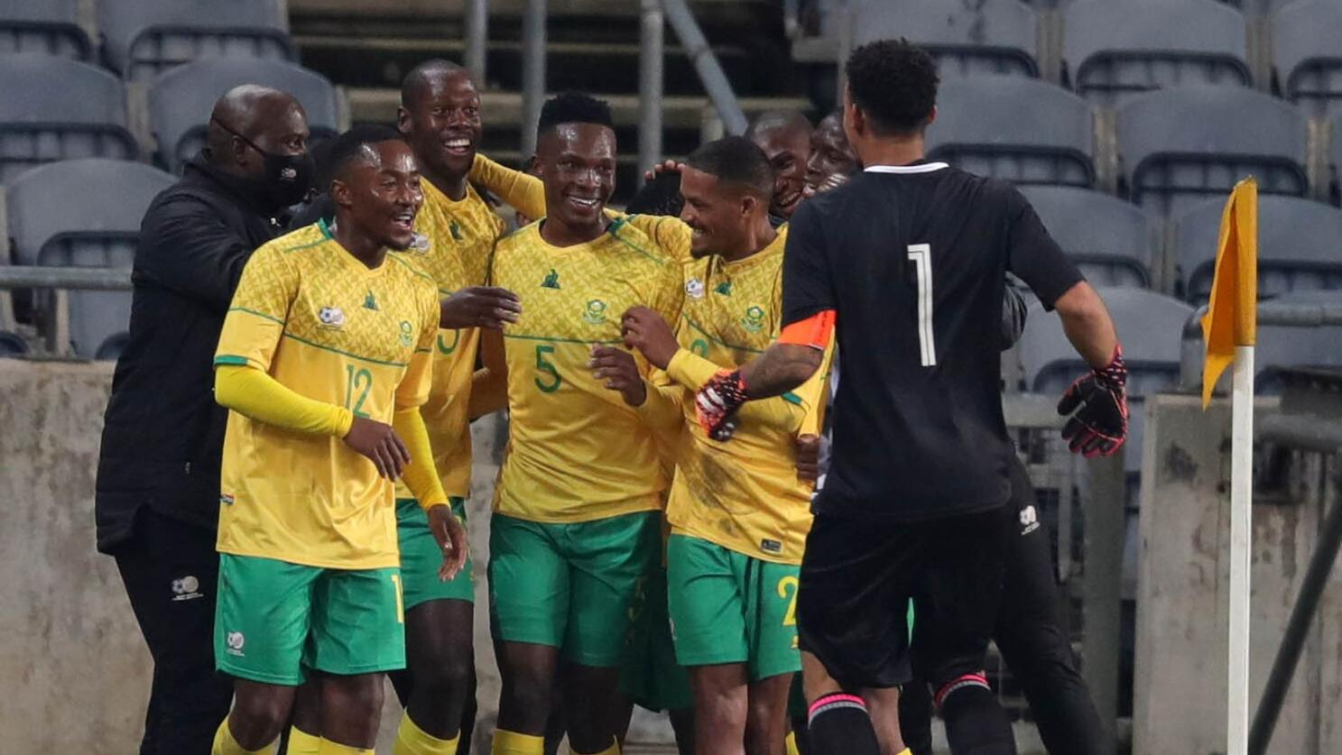 South Africa's Evidence Makgopa celebrates with teammates after scoring one of his two goals during their international friendly match against Uganda at Orlando Stadium in Johannesburg on Thursday