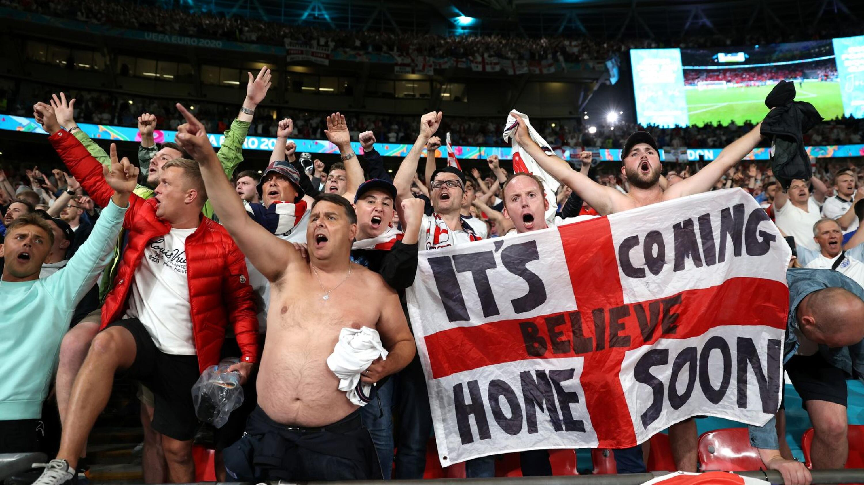 England fans celebrate after the Euro 2020 match against Denmark