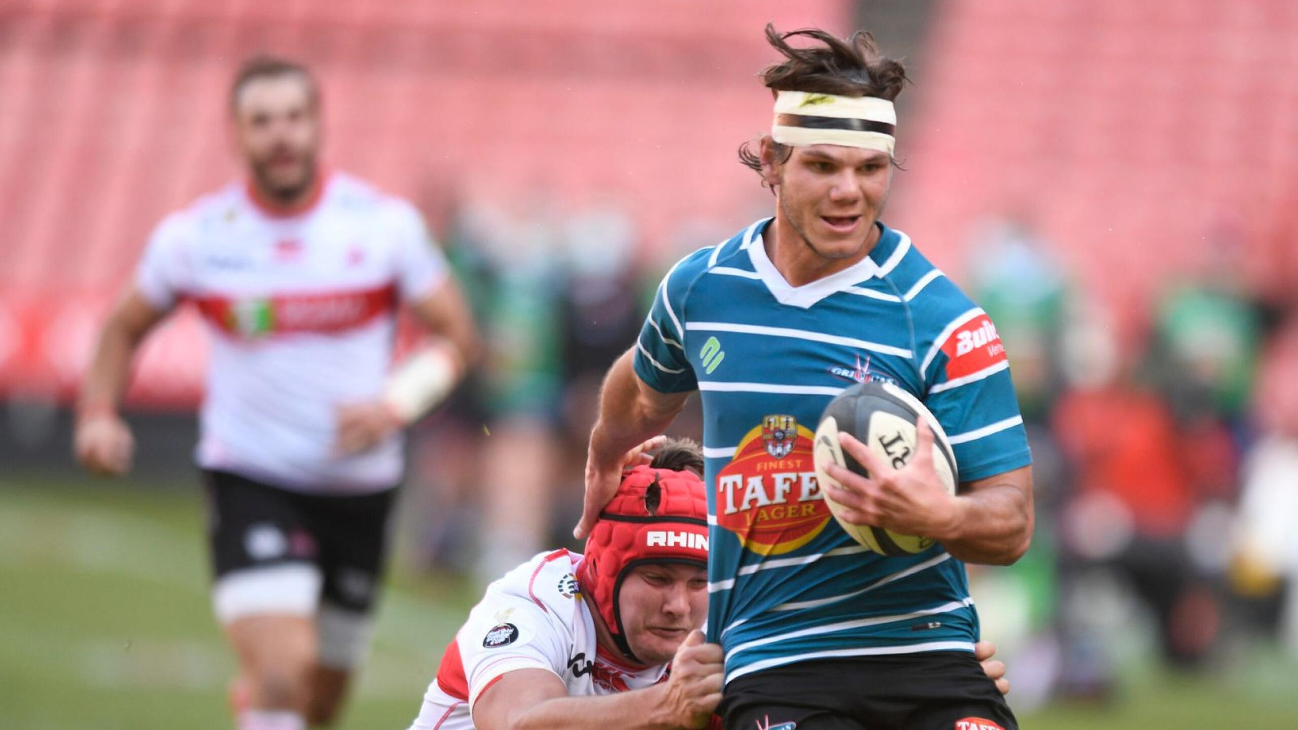 Griquas winger Eduan Keyter is tackled by Reinhardt Nothnagel of Lions during a Currie Cup match. Keyter has signed for the Sharks ahead of the United Rugby Championship