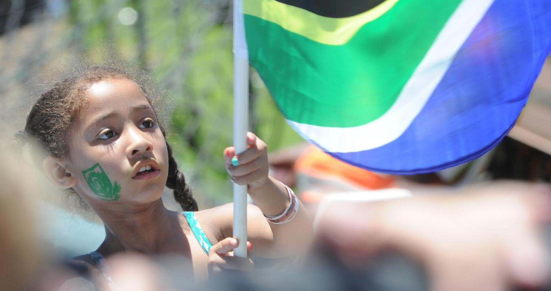 Girl waves the South African flag