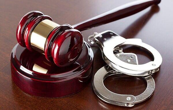 A judge's gavel and handcuffs