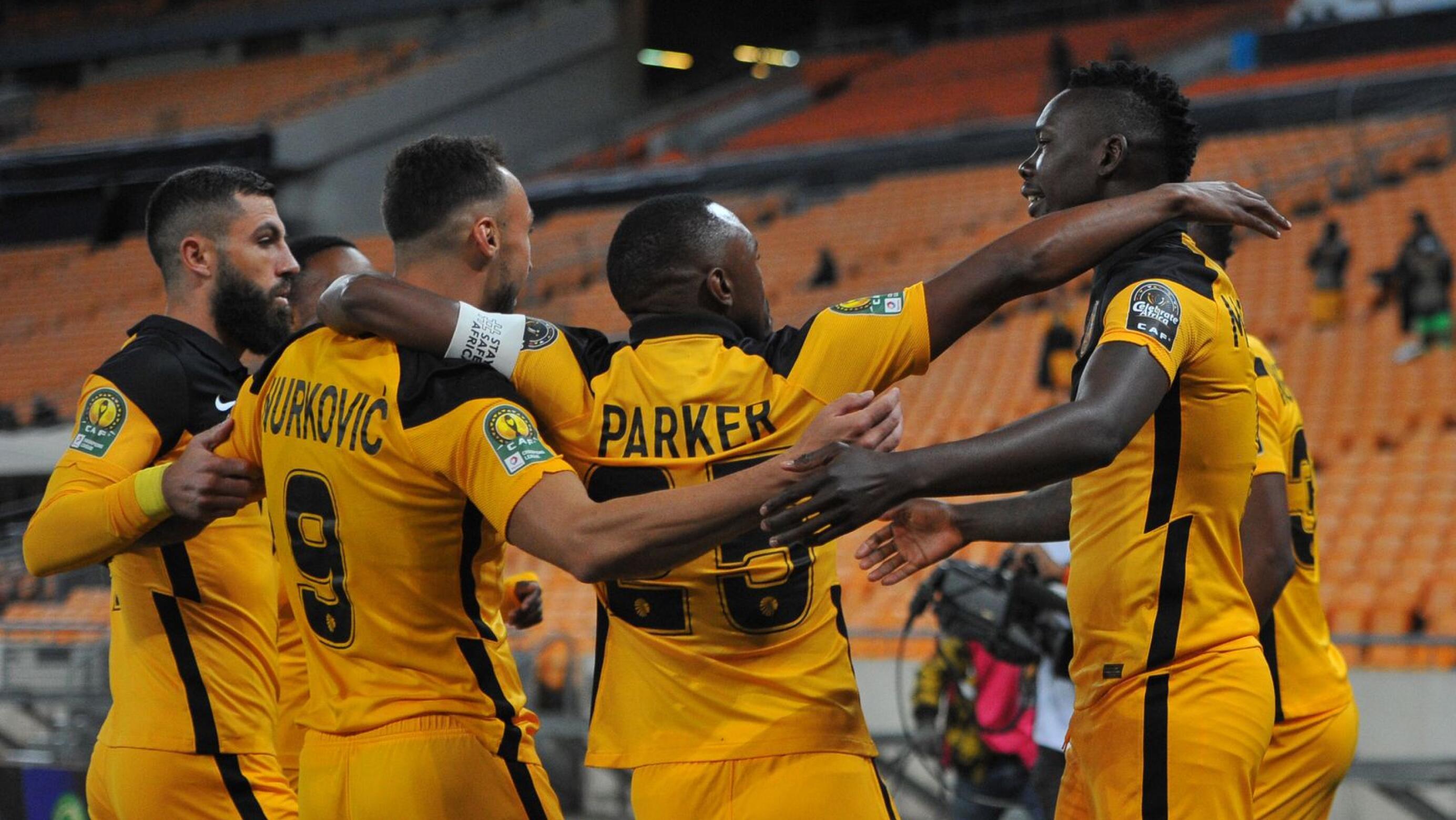 Erick Mathoho of Kaizer Chiefs celebrates with teammates after scoring