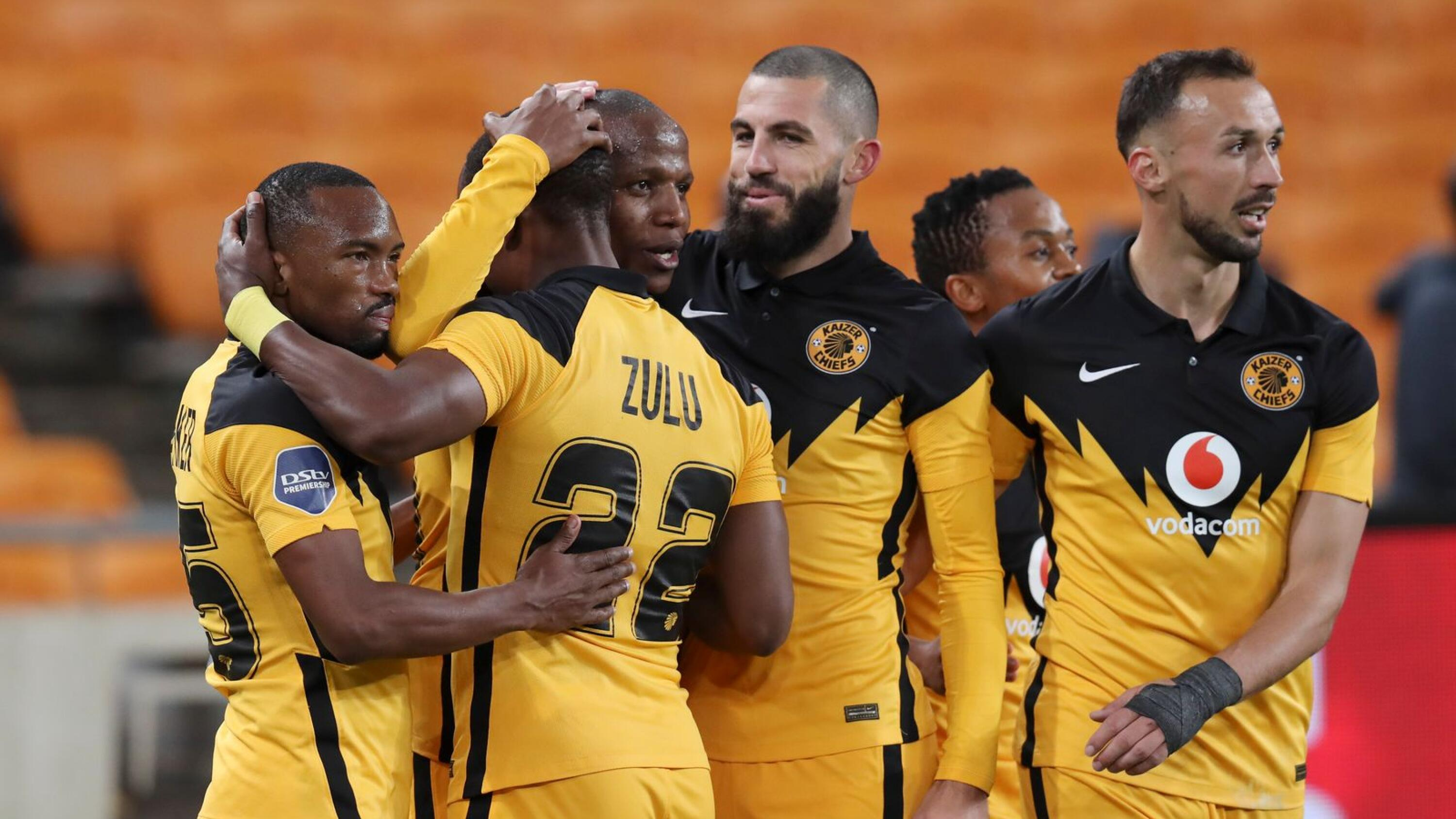Kaizer Chiefs players celebrate with Lebogang Manyama after he completed his hat-trick