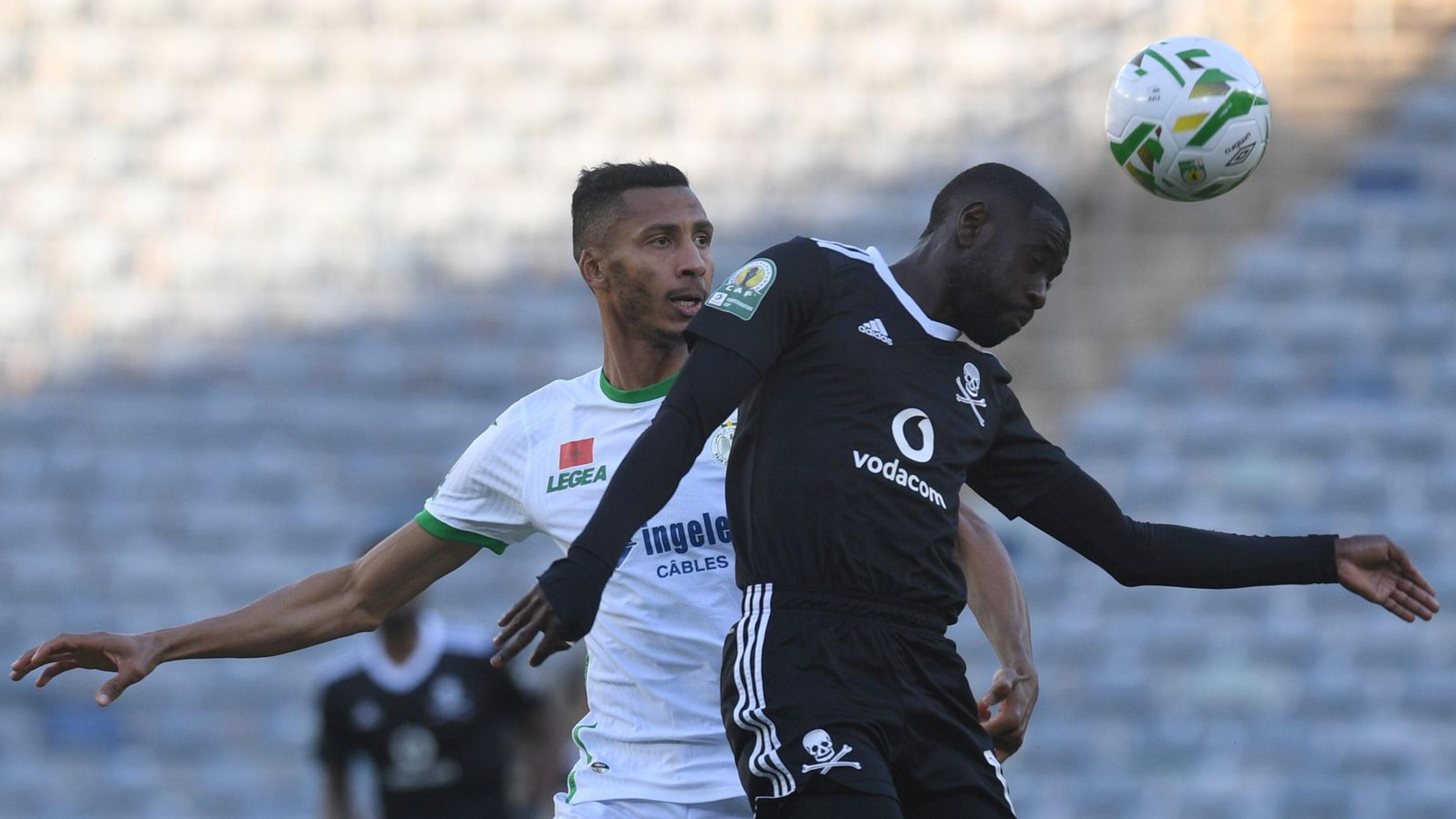 Deon Hotto of Orlando Pirates is challenged by Marouane Hadhoudi of Raja Casablanca
