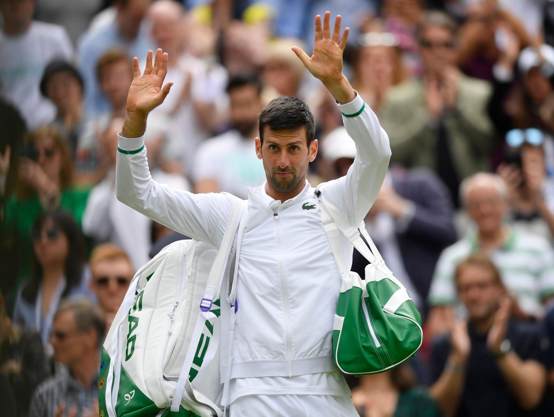 Serbia's Novak Djokovic applauds the fans after winning his Wimbledon quarter final match against Hungary's Marton Fucsovics