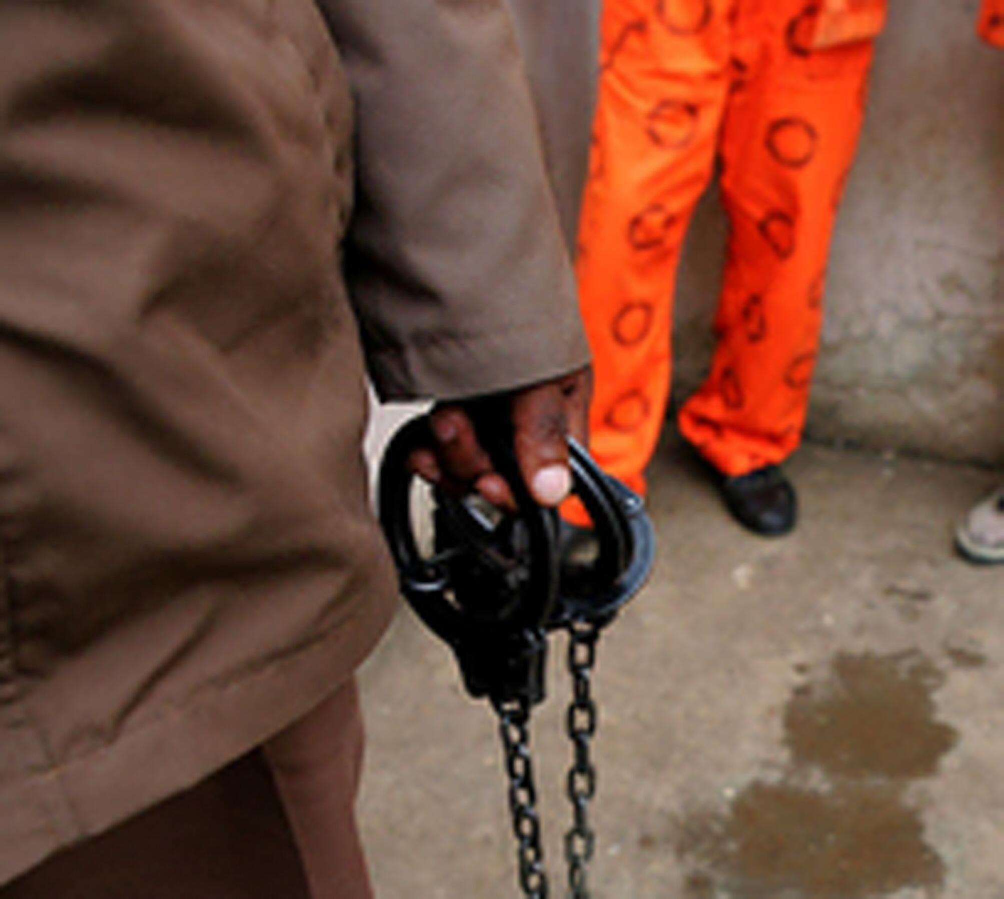 Prisoner in orange suit.