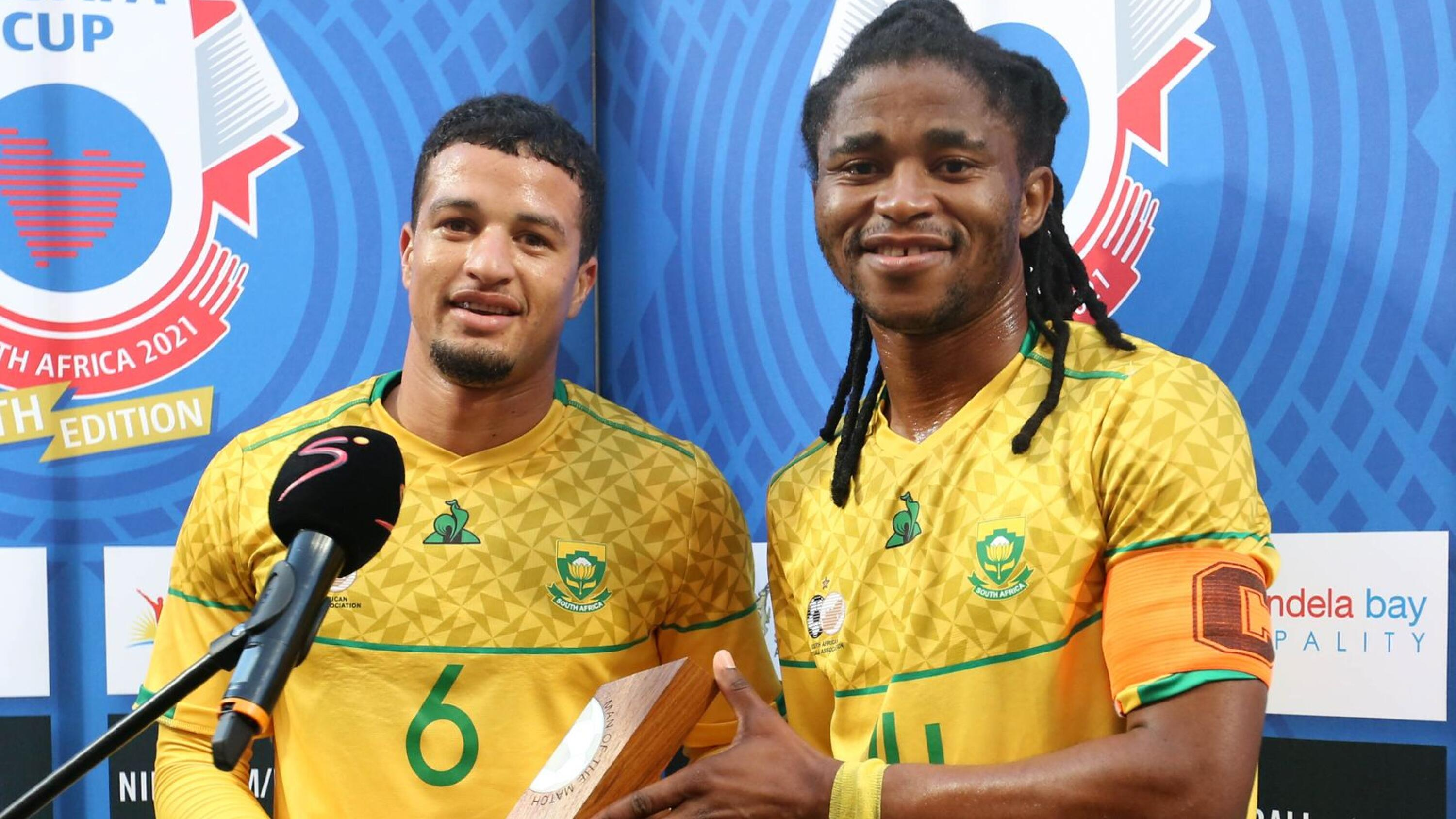 South Africa's Yusuf Maart receives the man of the match award from teammate Siyathemba Sithebe at the end of their Cosafa Cup match against Zambia at Nelson Mandela Bay Stadium in Gqeberha on Wednesday