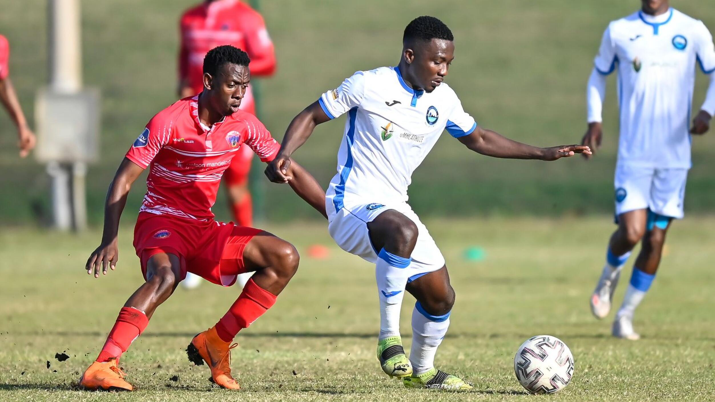 Maloisane Mokhele of Chippa United F.C. challenges Victor Bakah of Richards Bay FC during their relegation/promotion playoff game at Richards Bay Stadium on Saturday