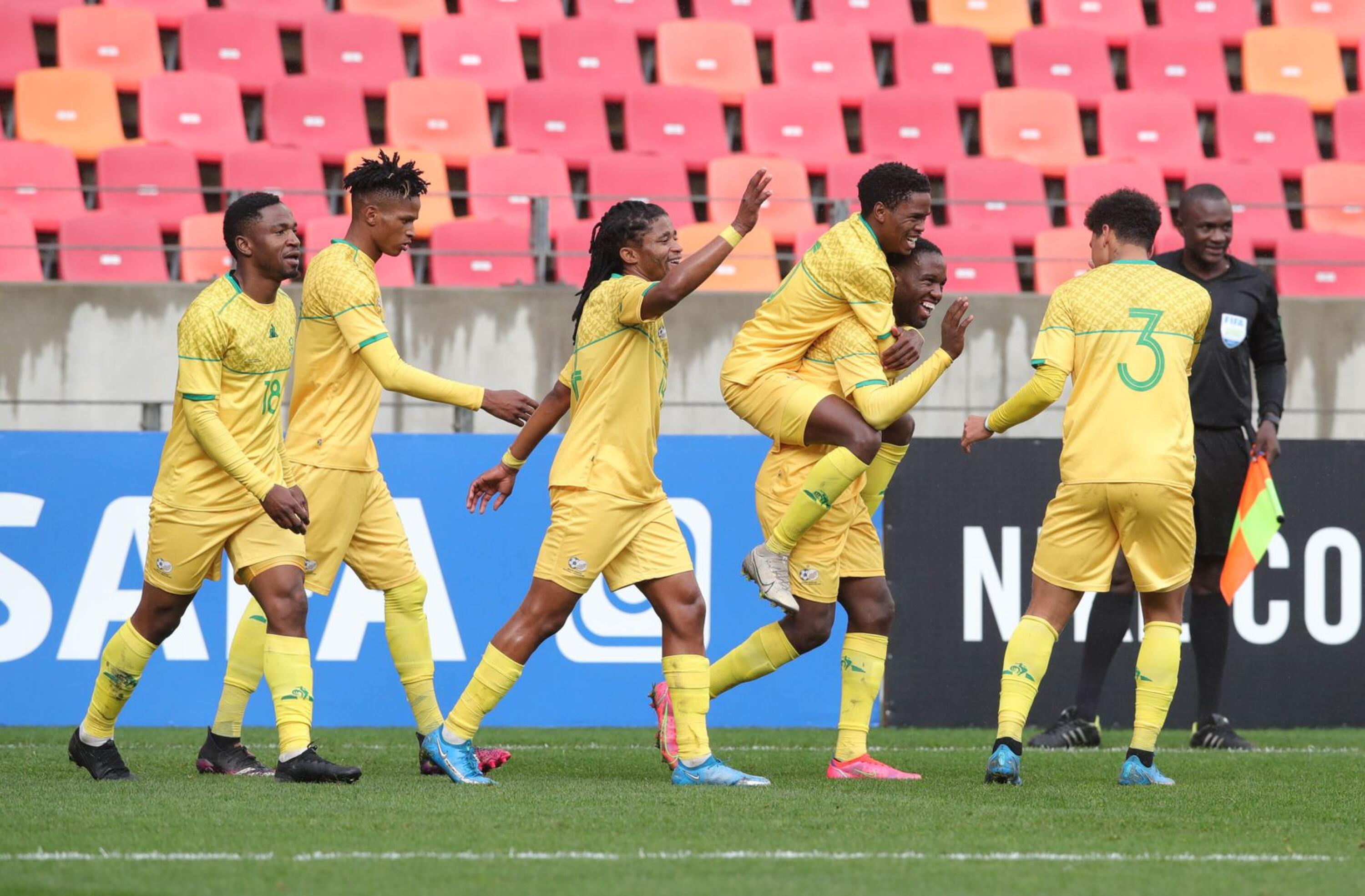 South Africa's Victor Letsoalo celebrates with teammates after scoring one of is three goals during their Cosafa Cup match against Lesotho at Nelson Mandela Bay Stadium in Gqeberha on Tuesday