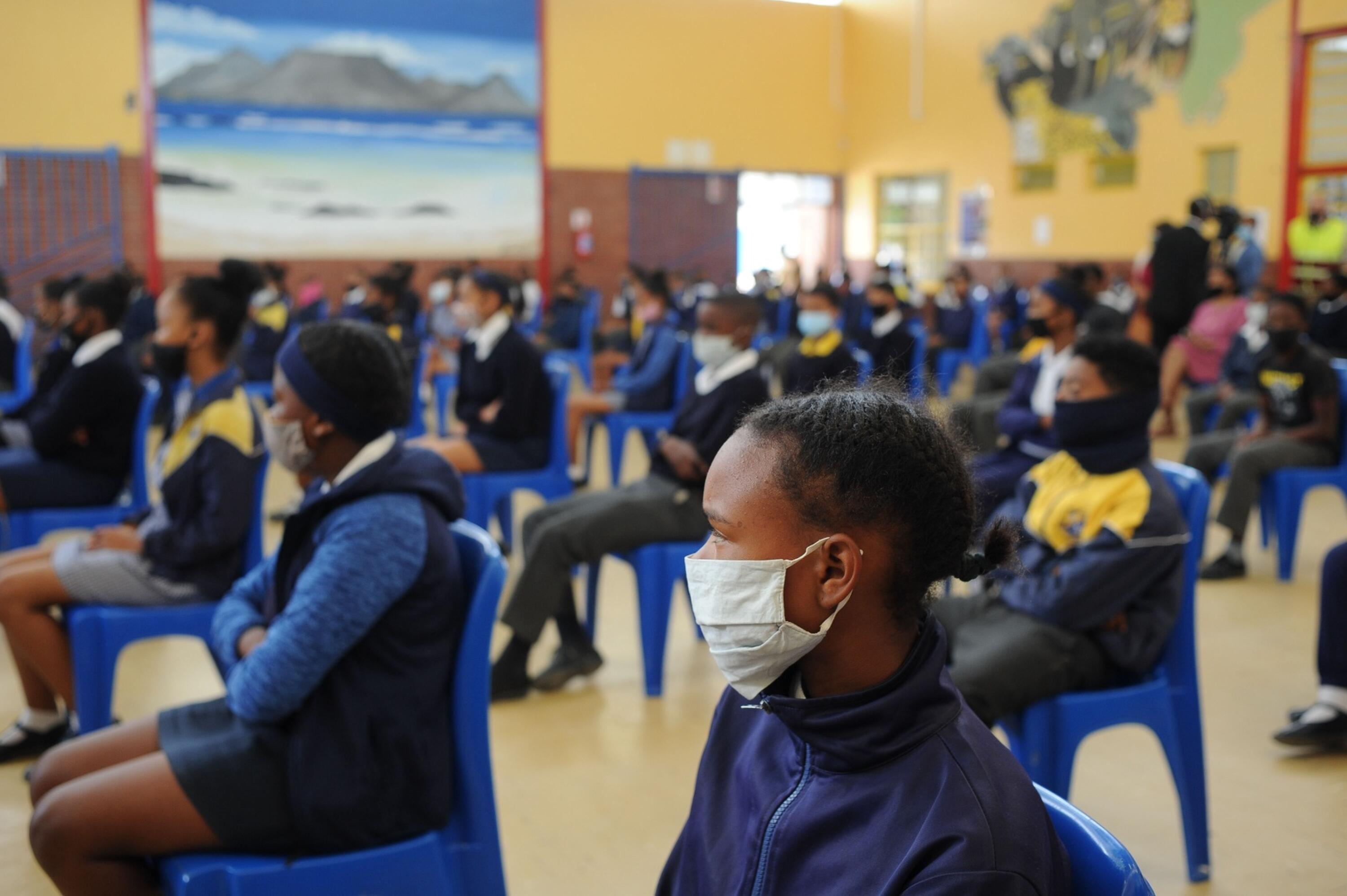 Learners sitting in a hall.