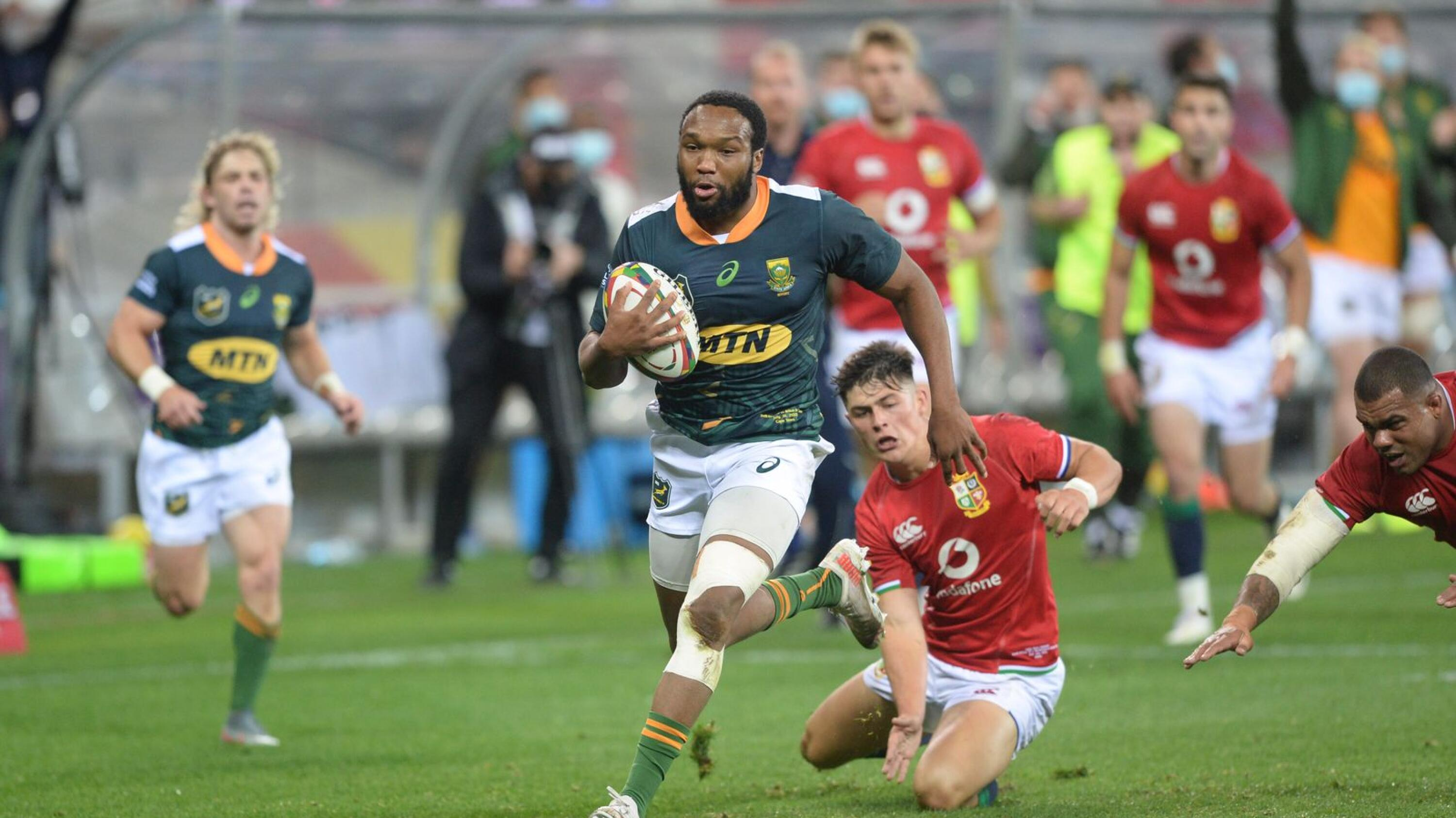 South Africa A's Lukhanyo Am breaks the British and Irish Lions line to score a try during their tour game at the Cape Town Stadium on Thursday