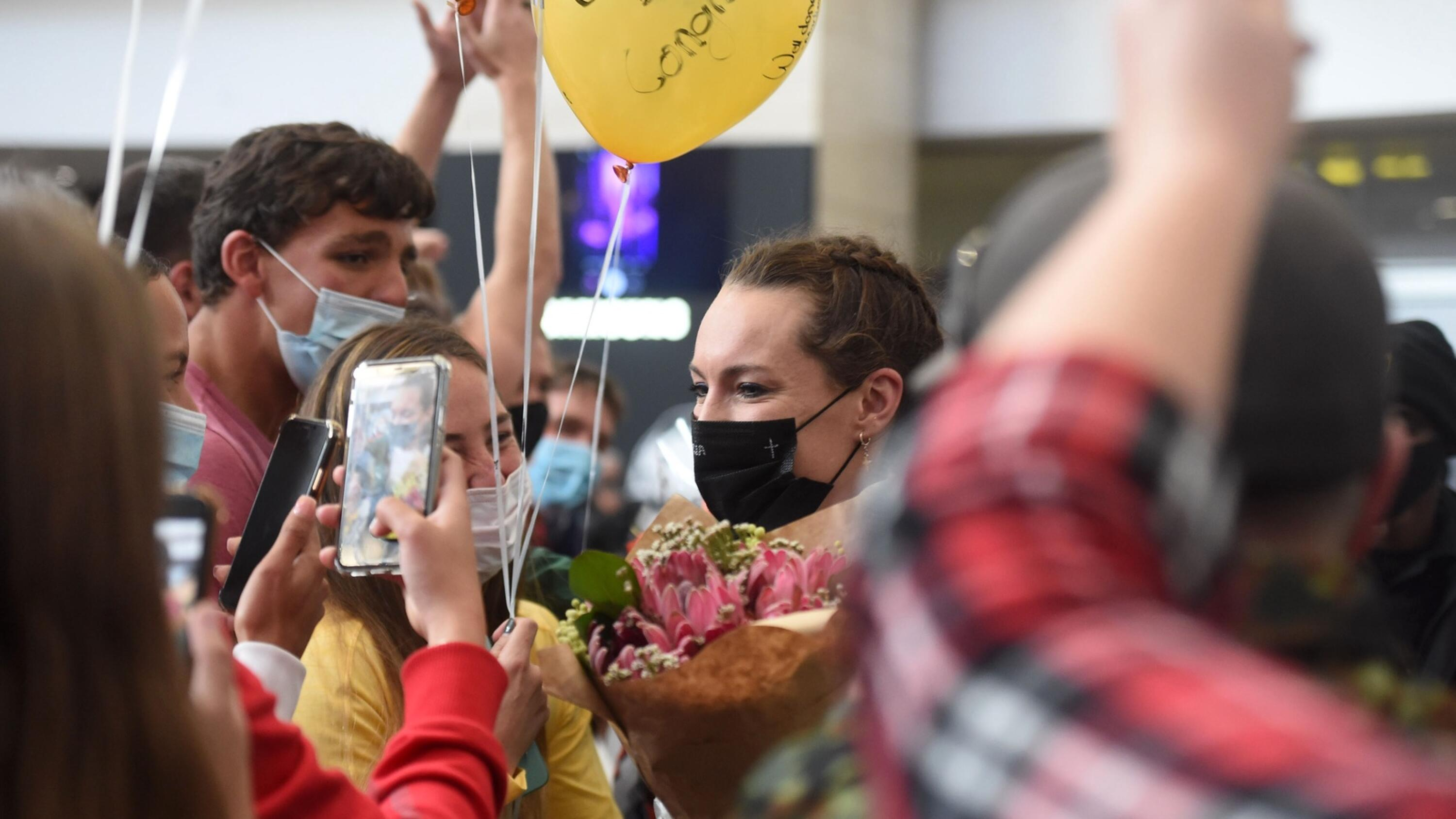 South Africa's Tatjana Schoemaker is greeted by friends and family as she arrives at OR Tambo international airport on Monday. Schoemaker won the women's 200m breaststroke in a time of 2.18.95, in a world record time, during the Tokyo Olympics