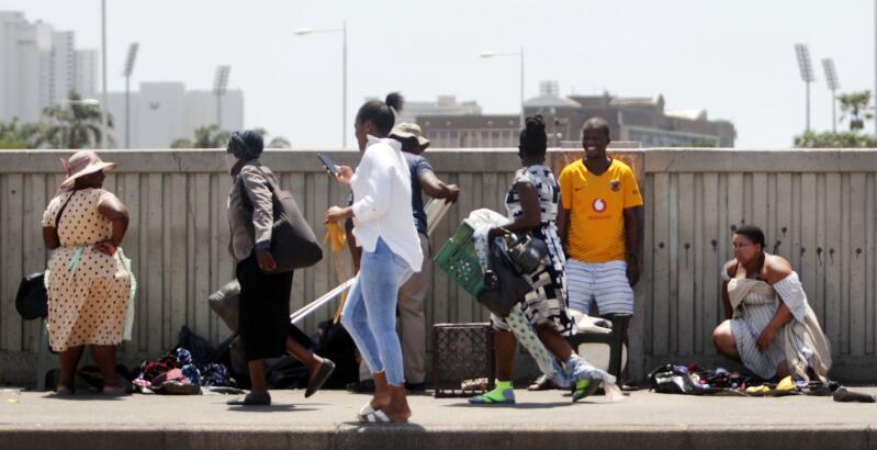 South Africans walk down the street in Durban.