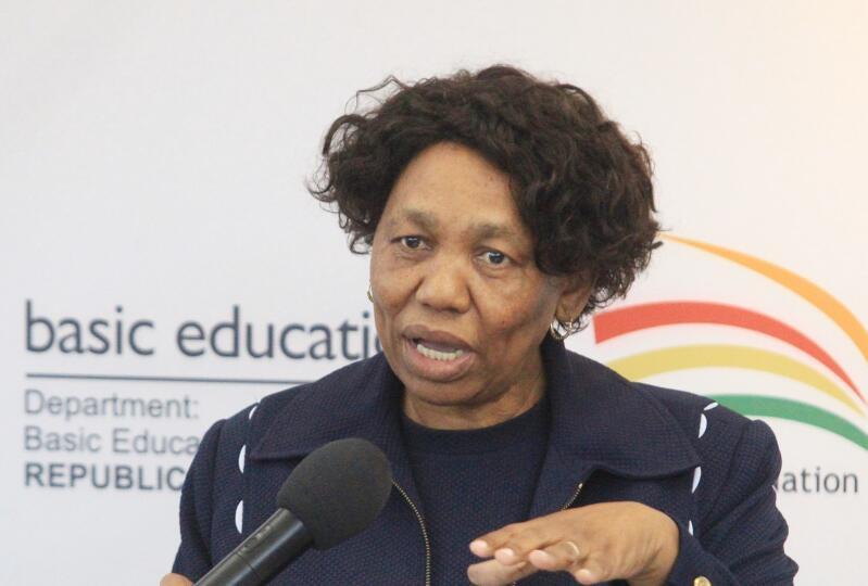 Angie Motshekga talking into a microphone